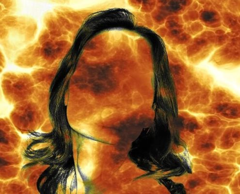 silhouette of woman with fire behind her