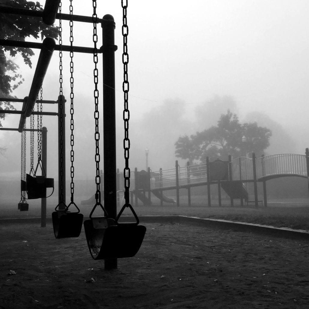 ominous fog around playground swings