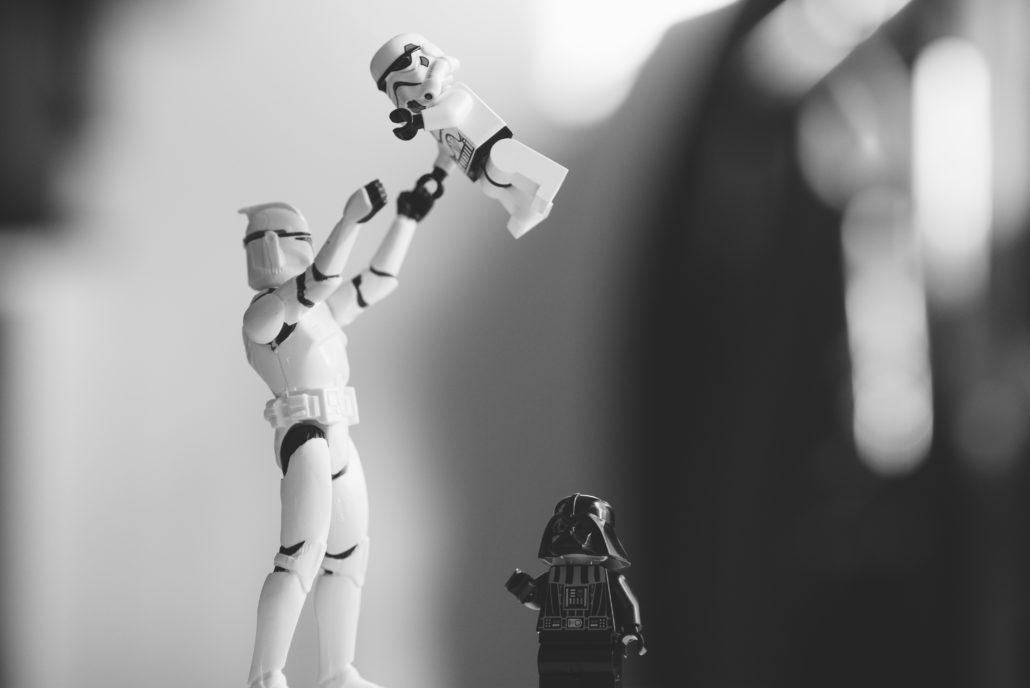 Star wars figures parent throwing child