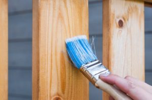 handyman painting fence