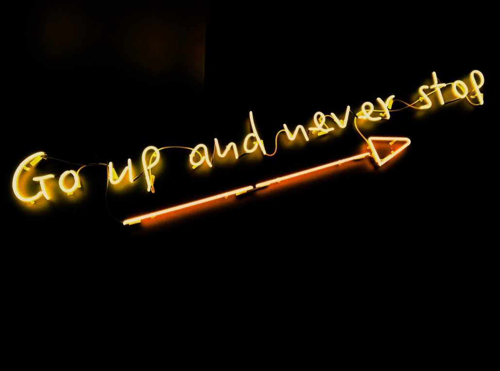 "neon sign, ""go up and never stop"""