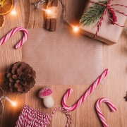 candy canes on table with pine cones and lights